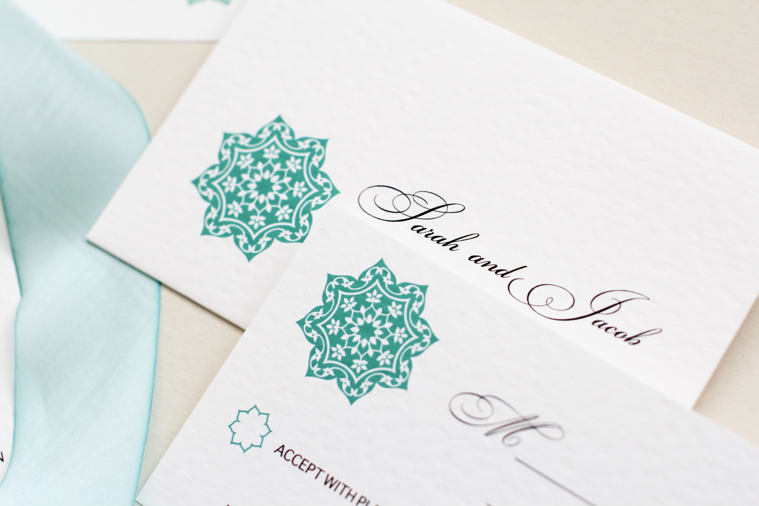 teal rosette design on envelopes