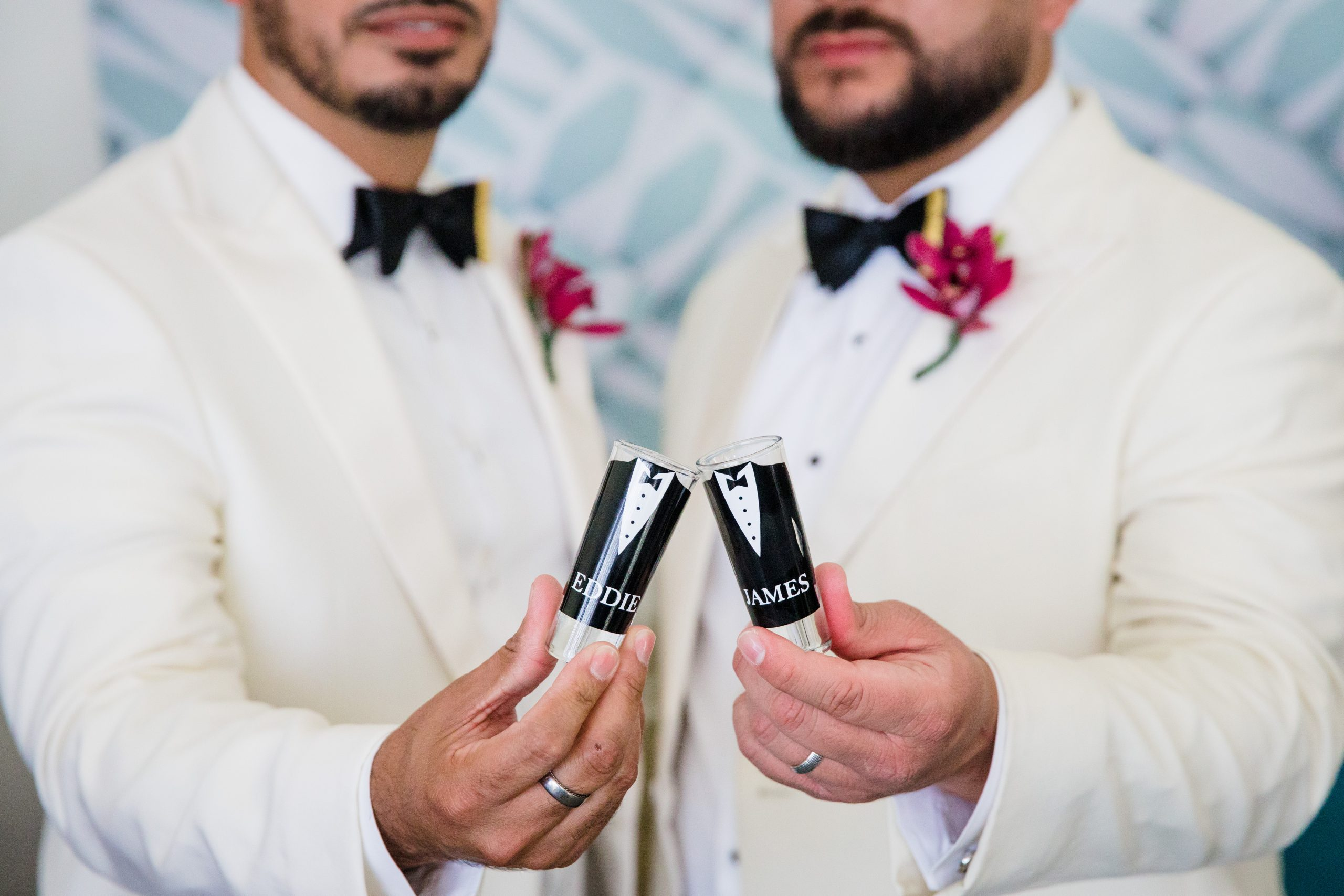 Two Groom toast to their wedding