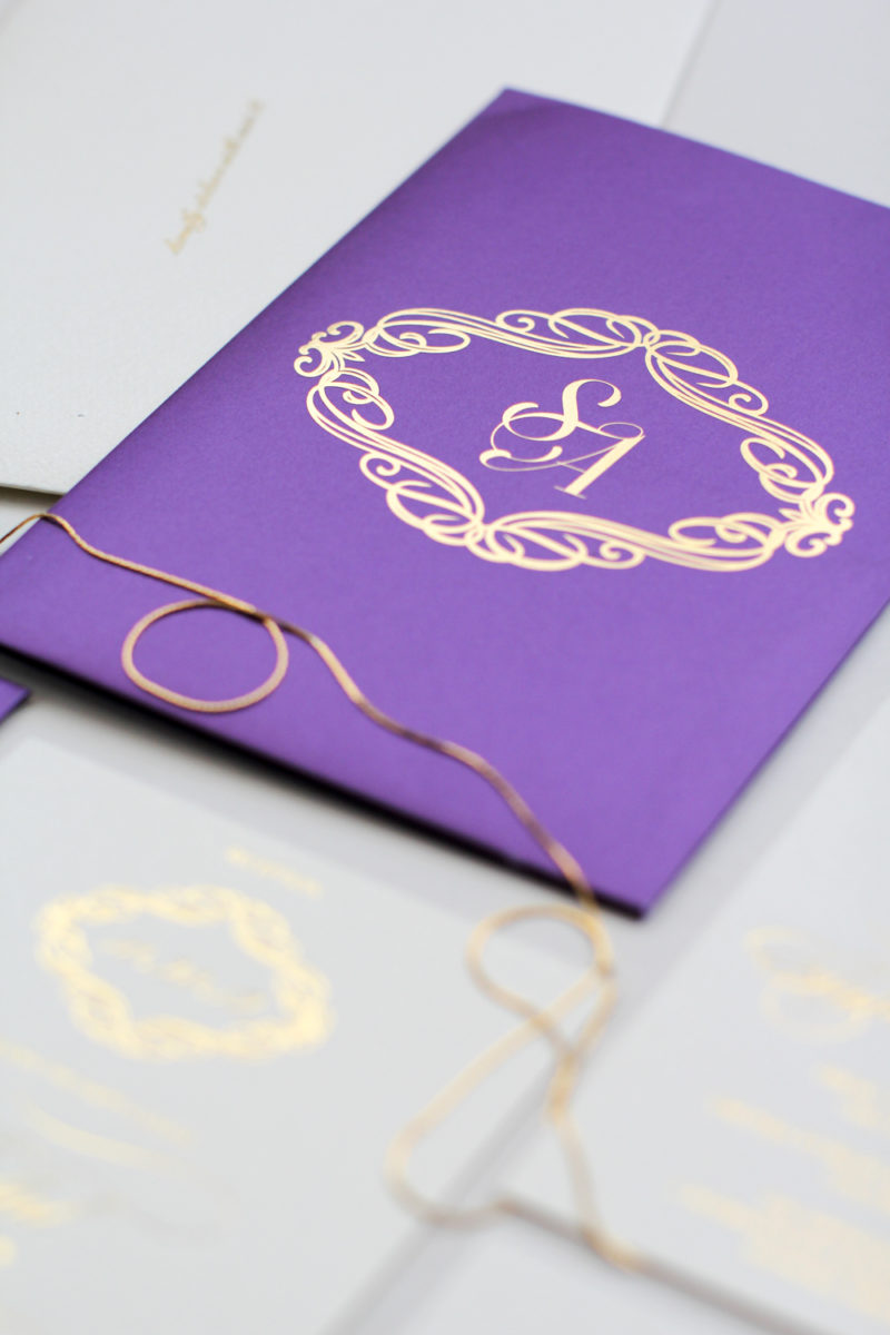 purple invitation with gold accents