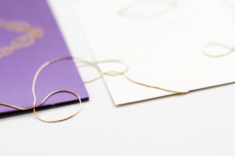 ivory invite with purple folio