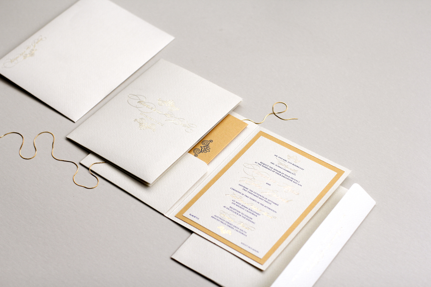gold foil pocket invitation with seashell inspired motif | AZURE