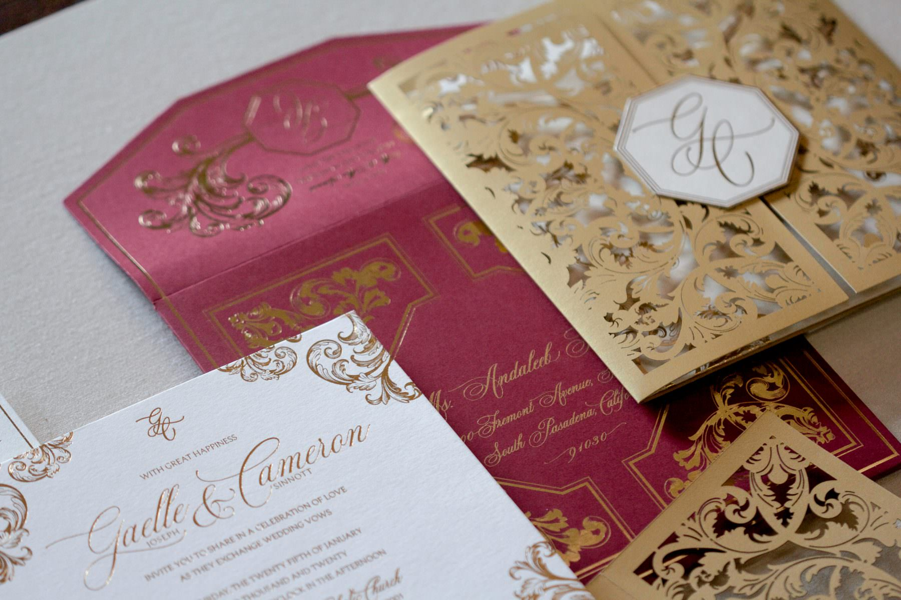 lasercut invitation with gold, ivory and burgundy