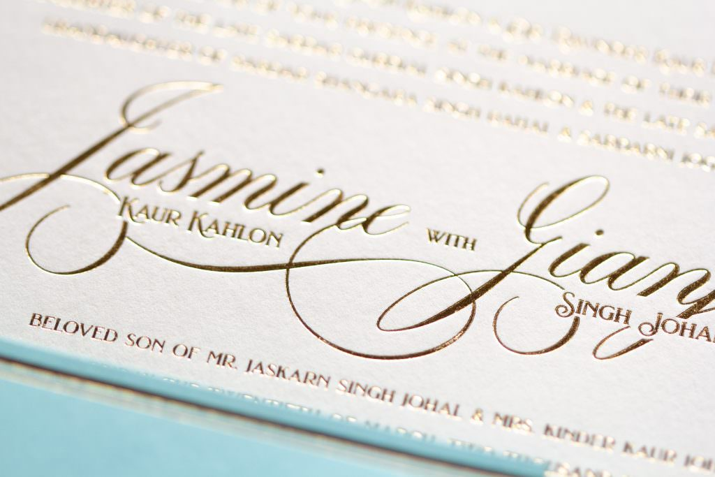 tiffany blue and ivory foil pressed invitation